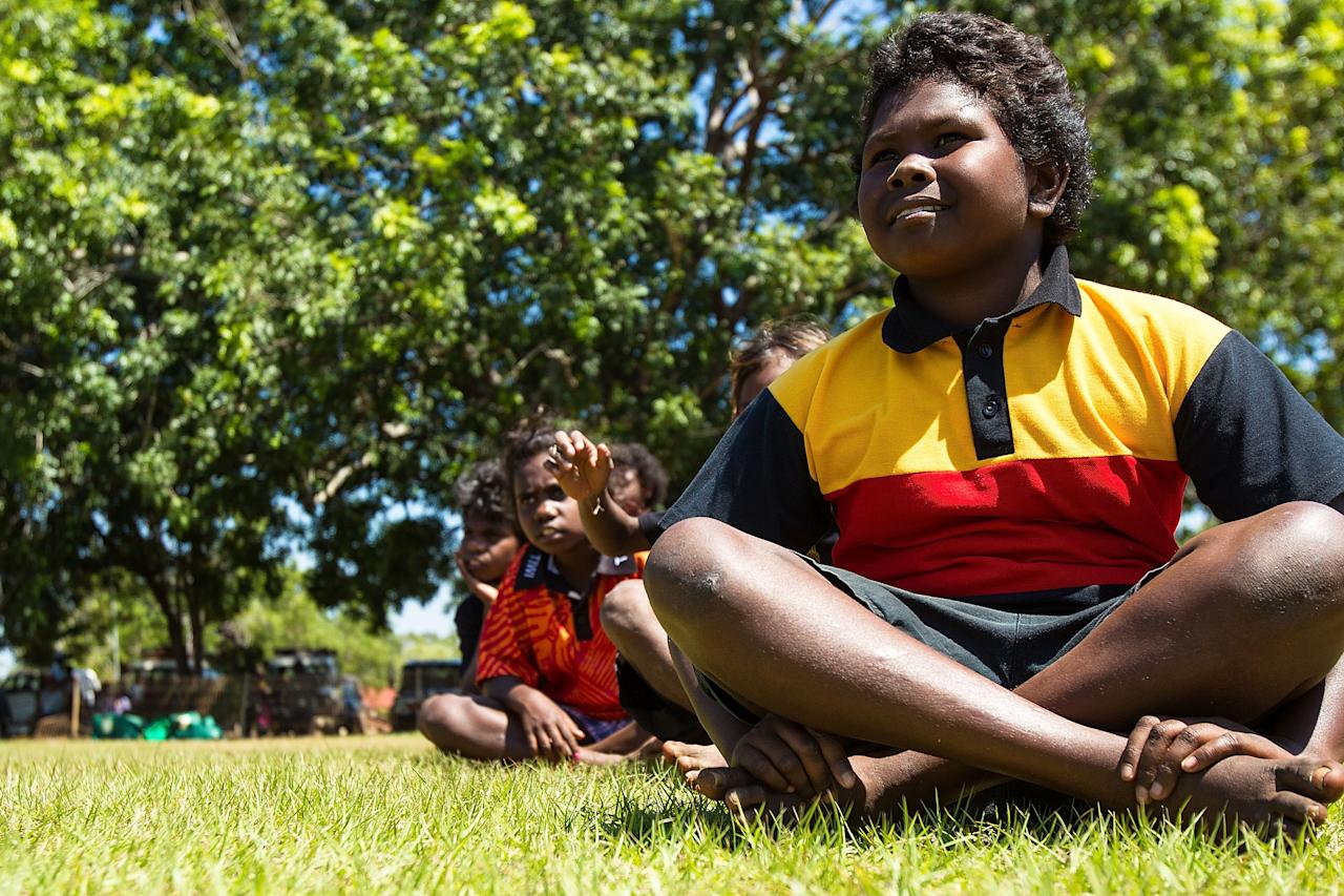 DARWIN, AUSTRALIA - AUGUST 10:  A child watches on during a visit by the Australian cricket team to Pirlangimpi of the Tiwi Islands on August 10, 2012 on the Tiwi Islands, Australia.  (Photo by Mark Nolan/Getty Images)