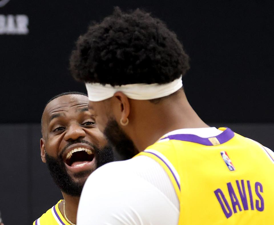LeBron James (left) and Anthony Davis led the way for the Lakers during their 2020 NBA title run. Can they do it again?