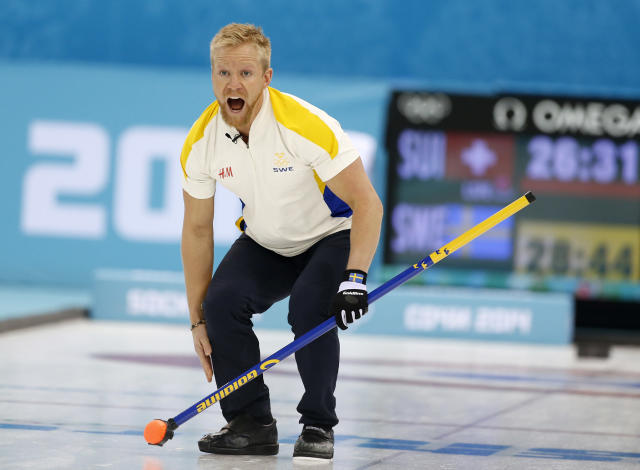 Sweden's skip Niklas Edin shouts instructions after delivering the rock in men's curling competition against Switzerland at the 2014 Winter Olympics, Monday, Feb. 10, 2014, in Sochi, Russia. (AP Photo/Robert F. Bukaty)