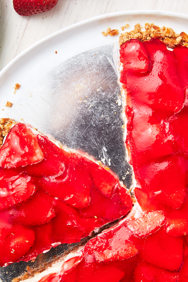 """<p>The pretzel crust perfectly compliments the sweet strawberries suspended in Jell-O. Even better is the rich cream cheese layer in the middle. Such a perfect dessert! </p><p>Get the <a href=""""https://www.delish.com/uk/cooking/recipes/a32485008/strawberry-pretzel-tart-recipe/"""" rel=""""nofollow noopener"""" target=""""_blank"""" data-ylk=""""slk:Strawberry Pretzel Tart"""" class=""""link rapid-noclick-resp"""">Strawberry Pretzel Tart</a> recipe.</p>"""
