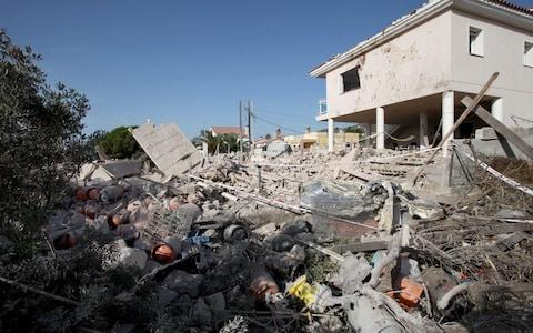 General view of the debris of a house after it completely collapsed after a gas leak explosion in a real state in the village of Alcanar, - Credit: JAUME SELLART/EPA