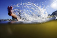 Water comes off the stoke of Matej Kozubek, of the Czech Republic, as he competes during the men's marathon swimming event at the 2020 Summer Olympics, Thursday, Aug. 5, 2021, in Tokyo. (AP Photo/David Goldman)