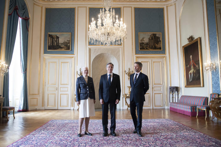 Denmark's Queen Margrethe II, left and Crown Prince Frederik, right, pose for a photo with US Secretary of State Antony Blinken, at Amalienborg Palace in Copenhagen, Denmark, Monday, May 17, 2021. Blinken is in Denmark for talks on climate change, Arctic policy and Russia as calls grow for the Biden administration to take a tougher and more active stance on spiraling Israeli-Palestinian violence. (Saul Loeb/Pool Photo via AP)