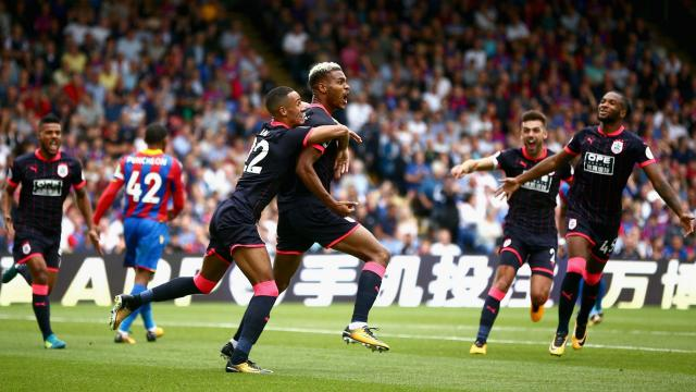 A Joel Ward own goal and Steve Mounie's double saw Huddersfield win on their Premier League debut at Crystal Palace 3-0.