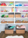 """<p>Keep your toy closet organized by dedicating each shelf to specific items. Try the top shelf for board games, second shelf for books, and bottom shelf for craft supplies and musical instruments.</p><p><strong>See more at</strong><strong> <a href=""""https://thehomeedit.com/"""" rel=""""nofollow noopener"""" target=""""_blank"""" data-ylk=""""slk:The Home Edit"""" class=""""link rapid-noclick-resp"""">The Home Edit</a>.</strong></p><p><strong><a class=""""link rapid-noclick-resp"""" href=""""https://www.amazon.com/MINTWOOD-Decorative-Laundry-Blanket-Storage/dp/B07PBXQNVD?tag=syn-yahoo-20&ascsubtag=%5Bartid%7C10063.g.36014277%5Bsrc%7Cyahoo-us"""" rel=""""nofollow noopener"""" target=""""_blank"""" data-ylk=""""slk:SHOP STORAGE BASKETS"""">SHOP STORAGE BASKETS</a><br></strong></p>"""