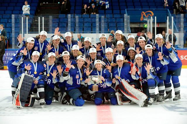 The U.S. team poses after their 2-1 shootout victory in the IIHF Women's Ice Hockey World Championships over Finland. (Mikko Stig/Lehtikuva via AP)