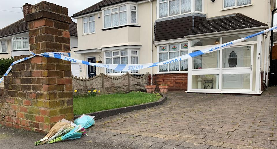 PABest Flowers outside the house on Boundary Avenue in Rowley Regis, West Midlands, where a woman in her 80s died after being attacked by two escaped dogs