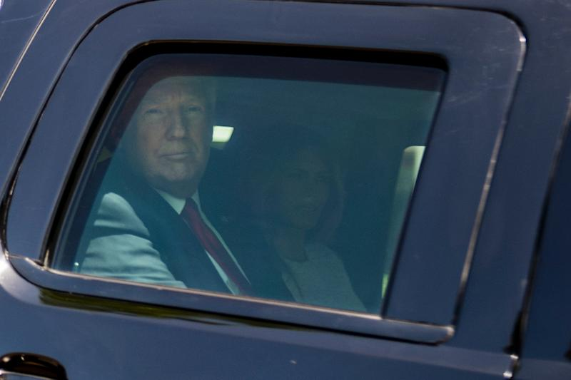 US President Donald Trump (L) and Melania Trump leave the Church of Bethesda-by-the-Sea after an Easter service in Palm Beach, Florida