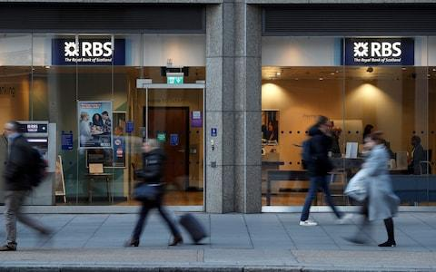 People walk past a branch of the Royal Bank of Scotland in London - Credit: Peter Nicholls/REUTERS