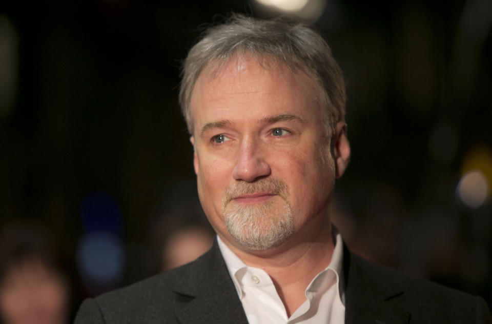 """HOLD FOR STORY - FILE - In this Jan. 13, 2013 file photo, director David Fincher arrives on the red carpet for the Netflix UK Premiere of 'House of Cards' at a Leicester Square cinema in London. Ben Affleck and Fincher are reteaming for a remake of Alfred Hitchcock's """"Strangers on a Train.""""  On the heels of their 2014 box-office hit"""