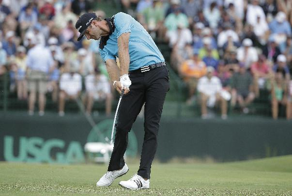 Dustin Johnson hits his tee shot on the 13th hole during the first round of the U.S. Open golf tournament in Pinehurst, N.C., Thursday, June 12, 2014. (AP Photo/Charlie Riedel)