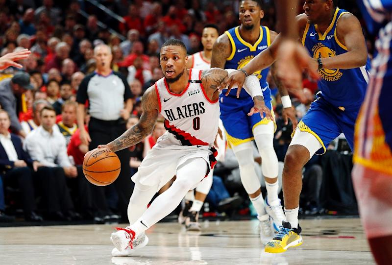 Portland's Damian Lillard drives in the Trail Blazers' overtime loss to the Golden State Warriors in game four of the NBA Western Conference finals (AFP Photo/JONATHAN FERREY)