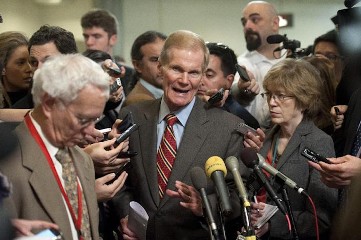 Senate Intelligence Committee member Sen. Bill Nelson, D-Fla., speaks with reporters on Capitol Hill in Washington, Friday, Nov. 16, 2012 following the committee's closed-door hearing where former CIA Director David Petraeus testified on the Sept. 11, 2012 attack in Libya. (AP Photo/Cliff Owen)