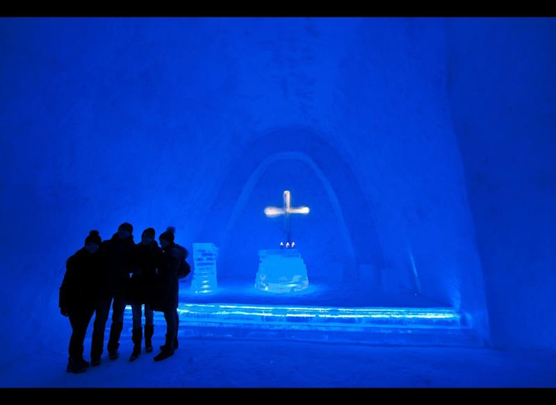 Visitors stand around a snow church just after its inauguration on Dec. 28, 2011 in Mitterfirmiansreut, Germany. The circa 25 meters long church was made of 1,400 cubic meters of snow and aims to commemorate the winter of the years 1910/1911, when so much snow fell that believers of Mitterfirmiansreut were no more able to go to church in the neighboring community of Mauth. So they decided to build their own church, made of snow. (Armin Weigel, AFP / Getty Images)