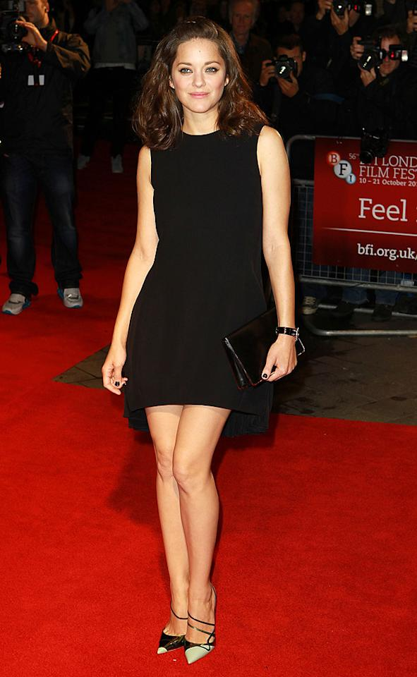 "Across the pond -- at the London Film Festival premiere of <a href=""http://movies.yahoo.com/movie/rust-and-bone/"" target=""_blank"">""Rust and Bone""</a> -- Marion Cotillard showed off her gorgeous gams in a divine Christian Dior LBD. Upstaging her dress, however, were a pair of two-toned Dior pumps, which took her look from fine to fabulous. (10/13/2012)"
