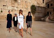 <p>The Trumps visited the Western Wall in Jerusalem, where FLOTUS wore a white suit with a pencil skirt and belted blazer by Michael Kors. </p>