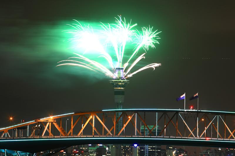 Fireworks are seen exploding from the Sky Tower with the Auckland Harbour Bridge in the foreground during the Auckland New Year's Eve celebrations on January 01, 2019 in Auckland, New Zealand.