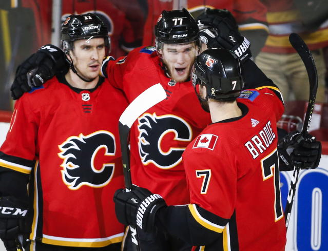 Calgary Flames' Mark Jankowski, centre, celebrates his goal with teammates during second period NHL hockey action against the Carolina Hurricanes, in Calgary, Tuesday, Jan. 22, 2019. (Jeff McIntosh/The Canadian Press via AP)