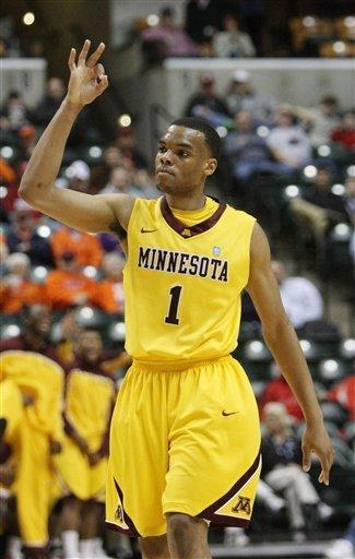 Minnesota guard Andre Hollins (1) reacts after scoring a three-point basket in the first half of an NCAA college basketball game against Northwestern at the first round of the Big Ten Conference tournament in Indianapolis, Thursday, March 8, 2012. (AP Photo/Kiichiro Sato)