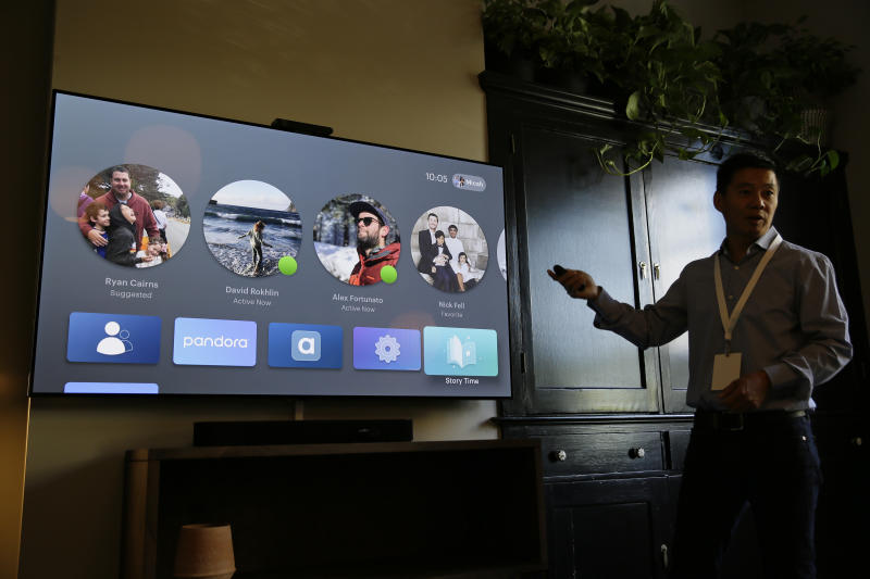 In this photo taken Tuesday, Sept. 17, 2019, product manager Bill Park demonstrates Facebook Portal TV during an event in San Francisco. Facebook is slashing the price and the size of the Portal, its screen and camera-equipped gadget for making video calls with friends and family as it attempts to get the device into more homes. A smaller version will now cost $129 and have an 8 inch display. A larger version will cost $179 and have a 10 inch display. (AP Photo/Eric Risberg)
