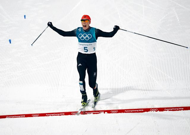 Nordic Combined Events – Pyeongchang 2018 Winter Olympics – Men's Individual 10km Final – Alpensia Cross-Country Skiing Centre - Pyeongchang, South Korea – February 14, 2018 - Eric Frenzel of Germany celebrates his win as he crosses the finish line. REUTERS/Kai Pfaffenbach TPX IMAGES OF THE DAY