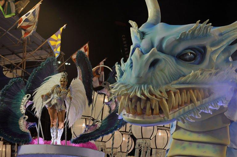 A reveler of the Inocentes de Belford-Roxo samba school performs atop a float in Rio de Janeiro on February 10, 2013