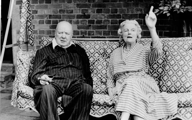 Former Prime Minister Winston Churchill with wife Clementine Churchill at Chartwell in 1951, a residence in Kent that had a 'sometimes-uncomfortable role that Britain, and Britons, have played in global history', according to the National Trust - Mirrorpix via Getty Images/Mirrorpix via Getty Images