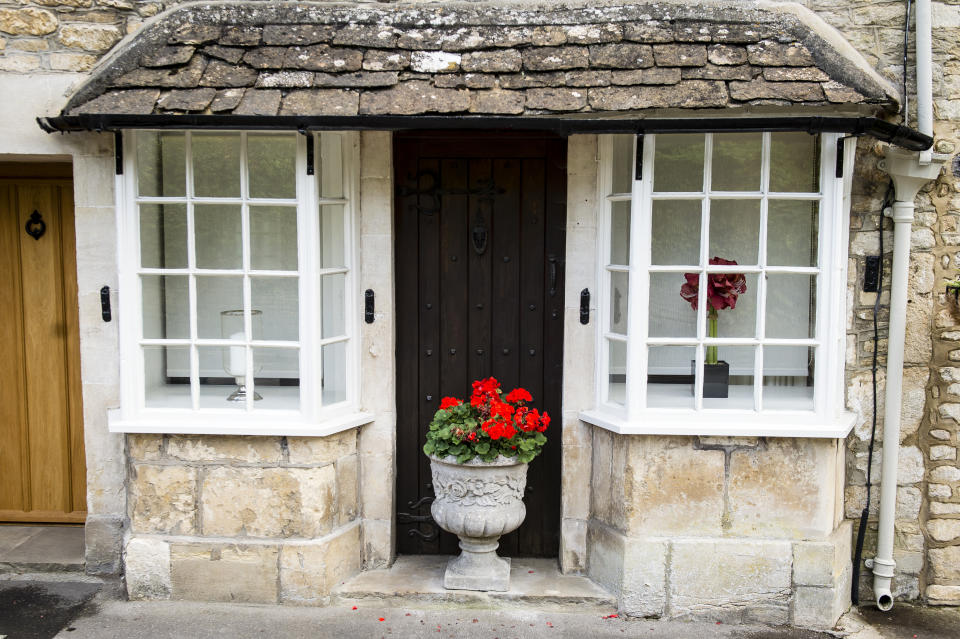 The front windows of a cottage in the village of Castle Combe, Wiltshire. PRESS ASSOCIATION Photo. Picture date: Thursday September, 24, 2015. Photo credit should read: Ben Birchall/PA Wire