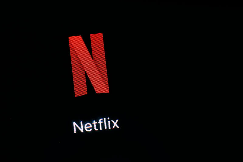 FILE- This March 19, 2018, file photo shows the Netflix app on an iPad in Baltimore. Netflix, Inc. reports earnings Monday, April 16, 2018. (AP Photo/Patrick Semansky, File)