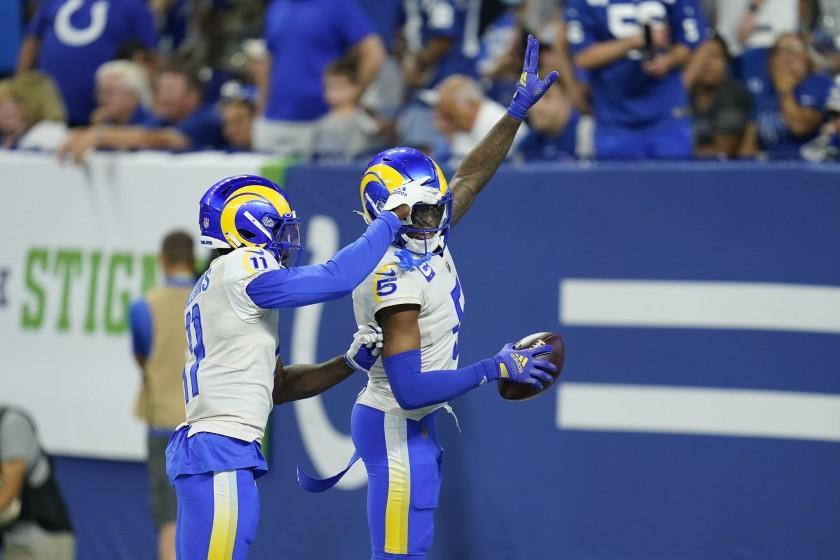 Los Angeles Rams' Jalen Ramsey (5) celebrates his interception with Darious Williams (11) during the second half of an NFL football game against the Indianapolis Colts, Sunday, Sept. 19, 2021, in Indianapolis. (AP Photo/Michael Conroy)