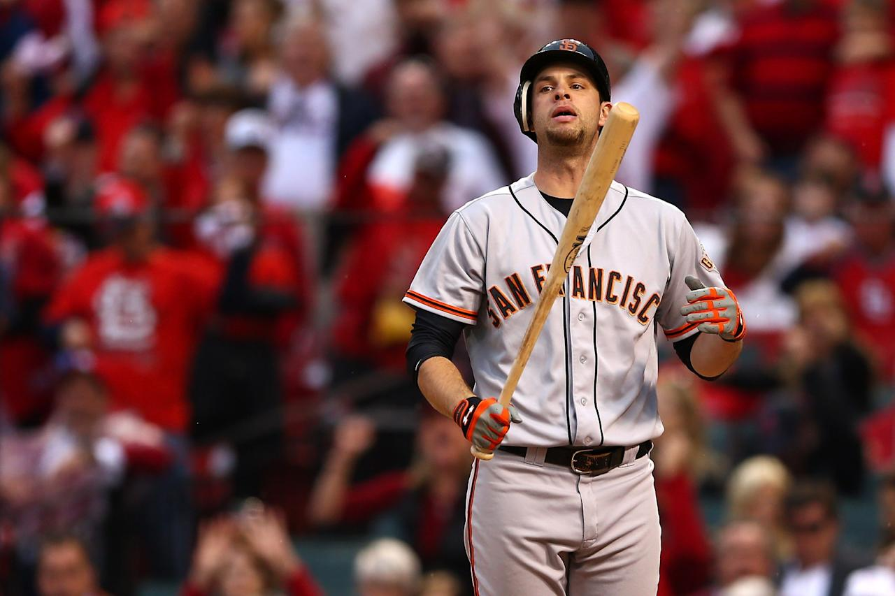 ST LOUIS, MO - OCTOBER 17:  Brandon Belt #9 of the San Francisco Giants reacts after striking out in the seventh inning against Mitchell Boggs #41 of the St. Louis Cardinals in Game Three of the National League Championship Series at Busch Stadium on October 17, 2012 in St Louis, Missouri.  (Photo by Elsa/Getty Images)
