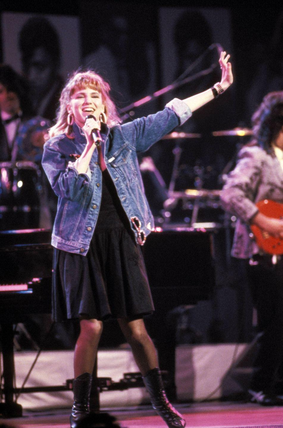 """<p>Gibson spent most of the '80s pumping out hits after the debut of """"Only in My Dreams."""" One of her biggest successes, <em>Electric Youth, </em>spent five weeks at No. 1 on the Top 200 Album chart. The teen pop superstar graced the cover of <em>Tiger Beat </em>and <em>YM. </em>Her trademark style of tight jeans and vests over T-shirts became part of quintessential '80s fashion.<br></p>"""