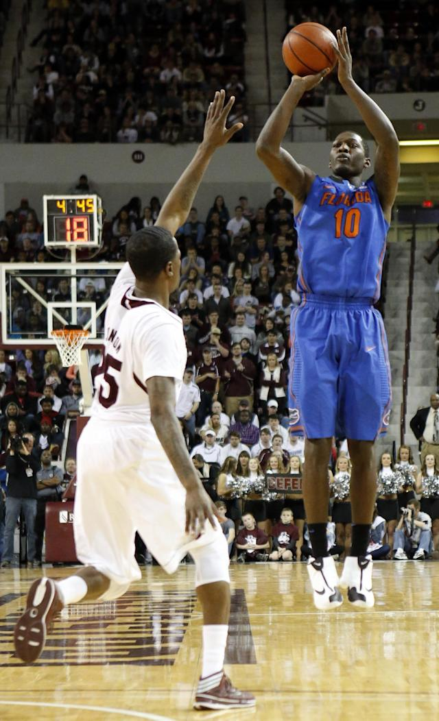 Florida forward Dorian Finney-Smith (10) shoots as Mississippi State forward Roquez Johnson (25) defends in the second half of an NCAA college basketball game in Starkville, Miss., Thursday, Jan. 30, 2014. No. 3 Florida won 62-51. (AP Photo)