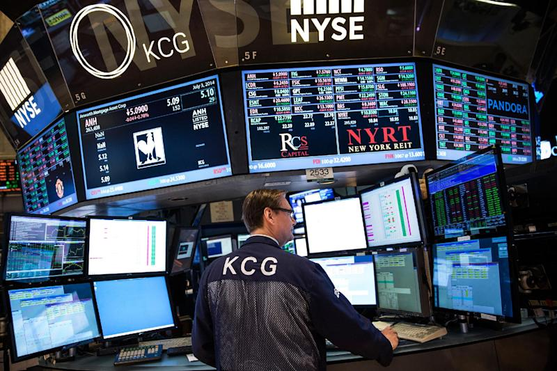 A trader works on the floor of the New York Stock Exchange during the morning of July 3, 2014 in New York City