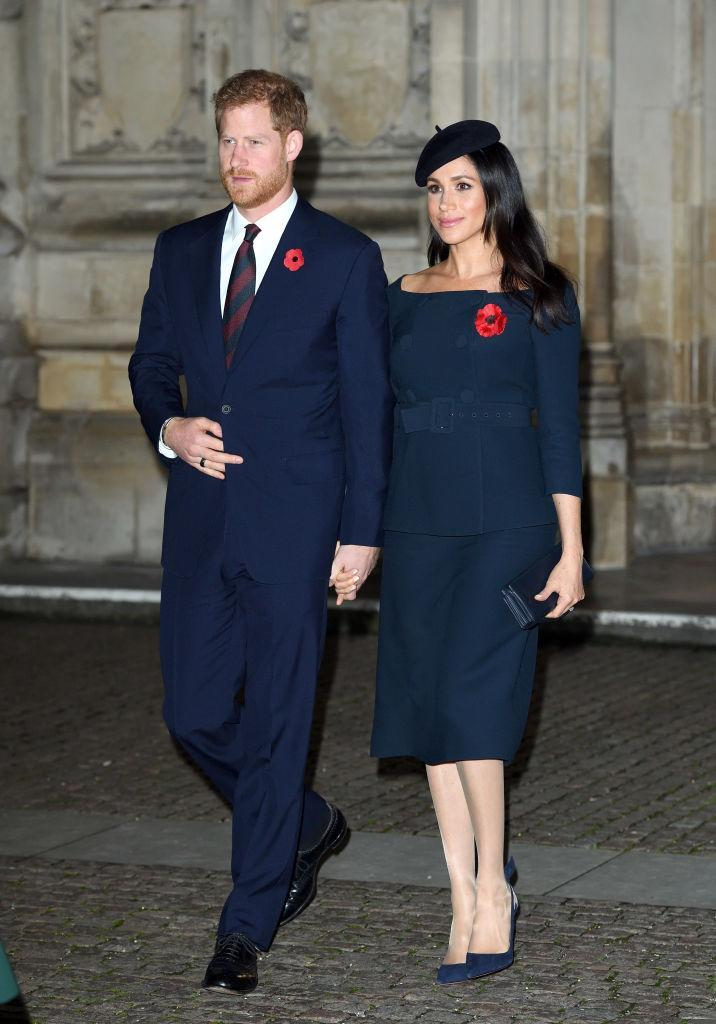 <p>Beneath her Stell McCartney coat, Meghan wore a navy cold-shoulder co-ord. She accessorised the look with a matching beret, Stella McCartney clutch and Manolo Blahnik heels. <em>[Photo: Getty]</em> </p>