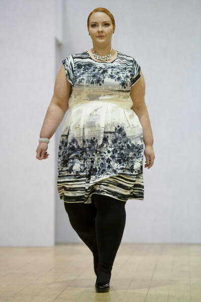 A model wears a design created by Plus Size Fashion during London Fashion Week Autumn/Winter 2014, at Vinopolis in central London, Friday, Feb. 14, 2014. (Photo by Jonathan Short/Invision/AP)