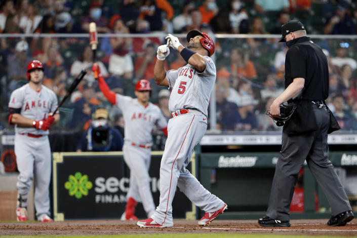 Los Angeles Angels' Albert Pujols (5) celebrates his home run as he crosses the plate during the second inning of a baseball game against the Houston Astros, Saturday, April 24, 2021, in Houston. (AP Photo/Michael Wyke)