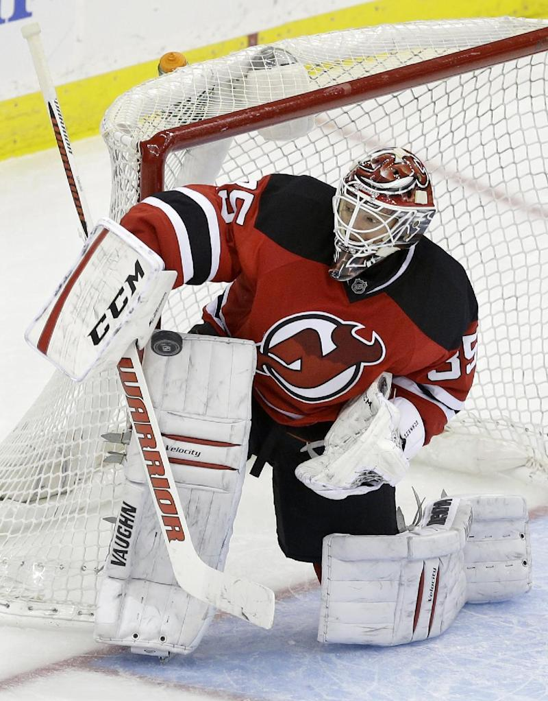 Brodeur glad to stick in goal with NJ Devils