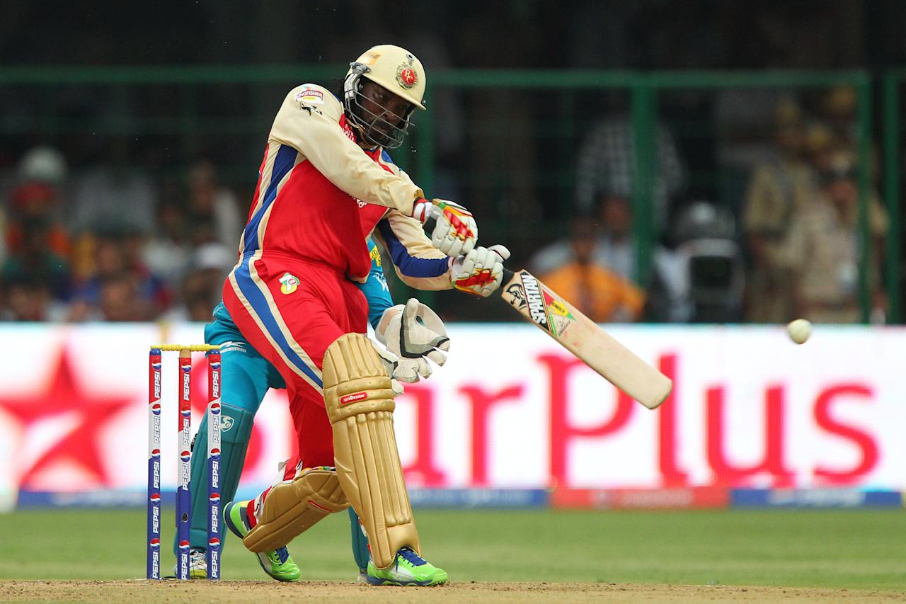 Chris Gayle during match 31 of the Pepsi Indian Premier League between The Royal Challengers Bangalore and The Pune Warriors India held at the M. Chinnaswamy Stadium, Bengaluru  on the 23rd April 2013..Photo by Ron Gaunt-IPL-SPORTZPICS ..Use of this image is subject to the terms and conditions as outlined by the BCCI. These terms can be found by following this link:..https://ec.yimg.com/ec?url=http%3a%2f%2fwww.sportzpics.co.za%2fimage%2fI0000SoRagM2cIEc&t=1500930224&sig=.5mK3I8oUeuwwdVejdJMFQ--~C