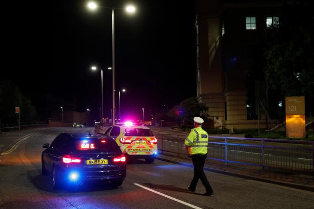 Police officers are seen at a police cordon in central Reading after the incident. (Getty)