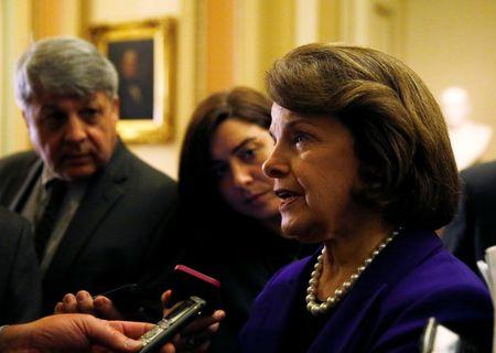 Senate Intelligence Committee chair Senator Dianne Feinstein talks to reporters after coming out of the Senate in Washington