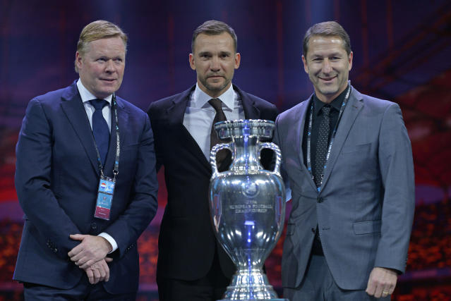 Netherlands coach Ronald Koeman, Ukraine coach Andriy Shevchenko and Austria coach Franco Foda pose for a photo during the draw for the UEFA Euro 2020 soccer tournament finals in Bucharest, Romania, Saturday, Nov. 30, 2019. (AP Photo/Andreea Alexandru)