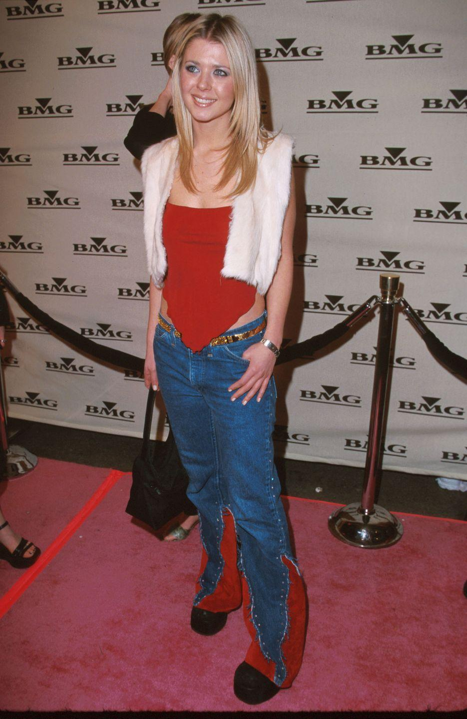 <p>Tara kept it casual at the after-party with some low-rise jeans that had killer red panels to match her red top and floofy white vest.</p>