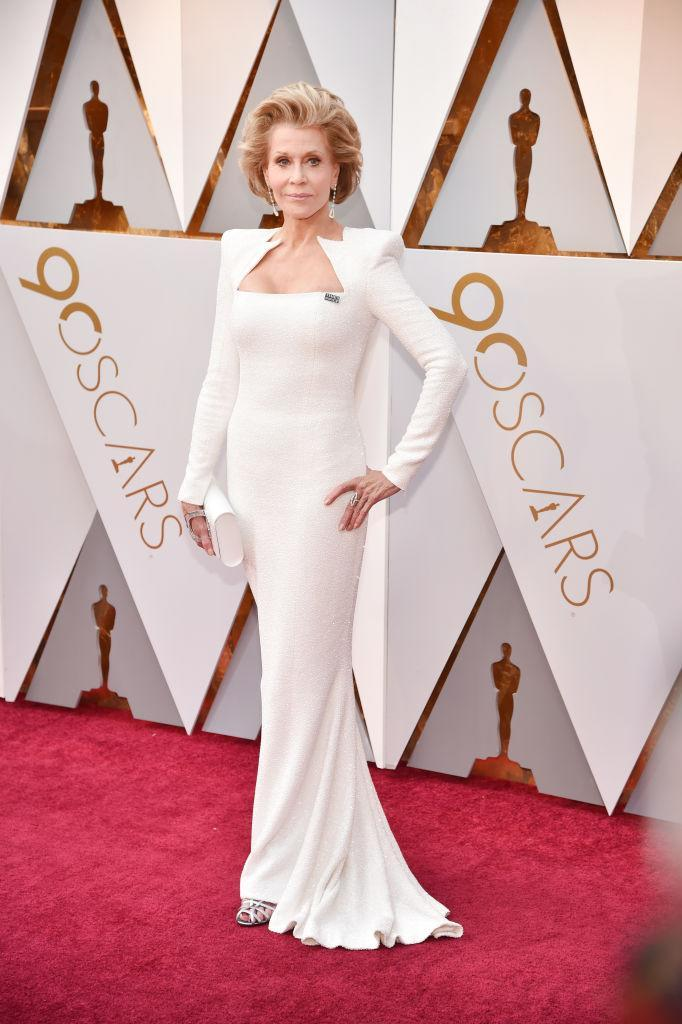 <p>White and bold white shoulder pads helped Jane Fonda shine at the 90th Annual Academy Awards in Hollywood. (Photo: Getty Images) </p>