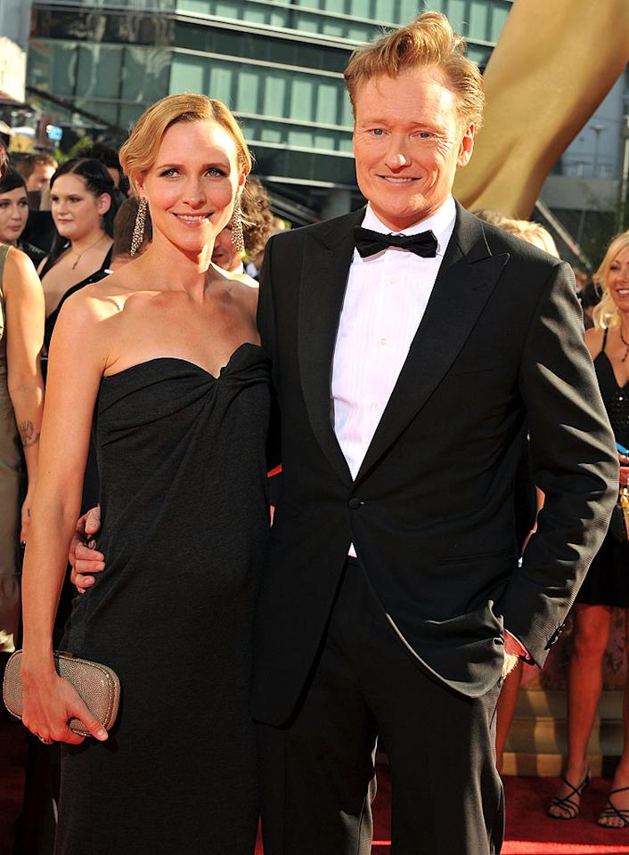 """Conan O'Brien (""""The Tonight Show With Conan O'Brien"""") and wife Eliza arrive at the 61st Primetime Emmy Awards held at the Nokia Theatre on September 20, 2009, in Los Angeles."""