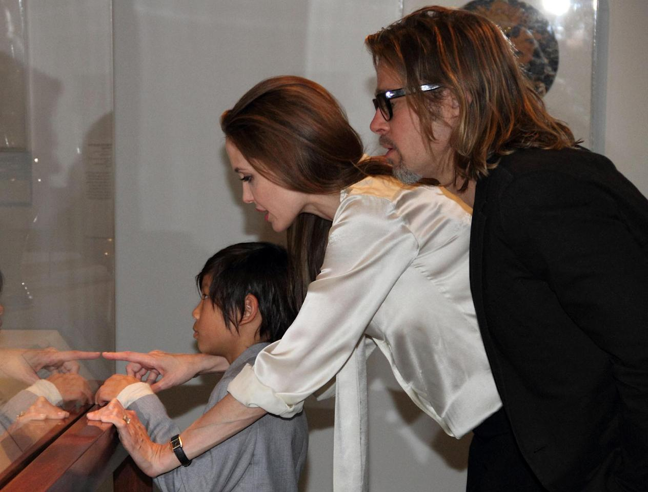 In this April 11, 2012 photo released by The Los Angeles County Museum of Art, actress Angelina Jolie, center, sports an engagement ring as she and Brad Pitt, and their son, Pax view works from the Chinese collection at the The Los Angeles County Museum of Art, in Los Angeles. Pitt's manager Cynthia Pett-Dante confirmed their engagement on Friday April 13, 2012. (AP Photo/LACMA, Howard Pasamanick via PR Newswire) EDITORIAL USE ONLY