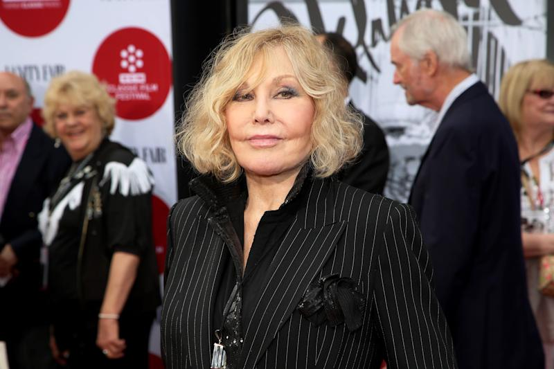 """FILE - In this Thursday, April 10, 2014 file photo, Kim Novak arrives at the 2014 TCM Classic Film Festival's Opening Night Gala at TCL Chinese Theatre in Los Angeles. Novak says that cruel jabs about how she looked during the Oscar March 2 ceremony amounted to bullying that left her at first crushed and then determined to speak out in protest. Turner Classic Movies host Robert Osborne agreed to discuss it during an interview with Novak that preceded a festival screening last Saturday, April 12, 2014, of her film """"Bell, Book and Candle."""" (Photo by Annie I. Bang /Invision/AP, file)"""