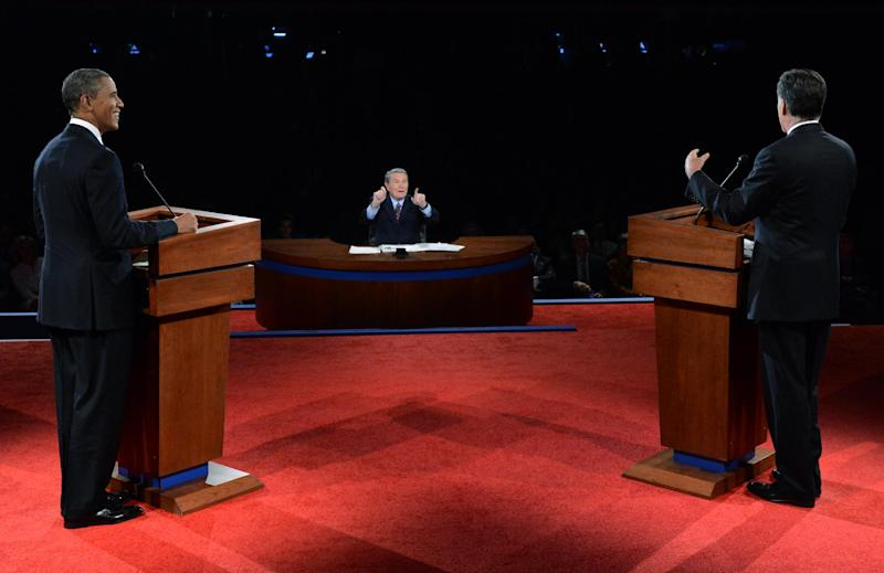 President Barack Obama and Republican presidential nominee Mitt Romney listen to a question from moderator Jim Lehrer during the first presidential debate at the University of Denver, Wednesday, Oct. 3, 2012, in Denver. (AP Photo/Pool-Michael Reynolds)