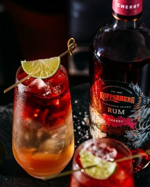"""<p>Mix the juice of half a lime and 2 teaspoons of brown sugar in the bottom of a high ball glass. Fill with cubed ice, before topping with 200ml ginger ale. Pour 50ml <a href=""""https://www.amazon.co.uk/Kopparberg-Cherry-Spiced-70cl-KOPRUMCH6PK/dp/B08BTJR39N/ref=sr_1_1?dchild=1&keywords=Kopparberg+Cherry+Spiced+Rum&qid=1605624913&quartzVehicle=80-1026&replacementKeywords=kopparberg+spiced+rum&sr=8-1&tag=hearstuk-yahoo-21&ascsubtag=%5Bartid%7C1919.g.34687711%5Bsrc%7Cyahoo-uk"""" rel=""""nofollow noopener"""" target=""""_blank"""" data-ylk=""""slk:Kopparberg Cherry Spiced Rum"""" class=""""link rapid-noclick-resp"""">Kopparberg Cherry Spiced Rum </a>over the top and garnish with a skewered lime wedge.<br></p>"""