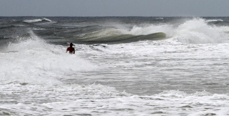 A young man takes advantage of the big waves from Tropical Storm Isaac in Gulf Shores, Ala. on Monday, Aug. 27, 2012. The National Hurricane Center predicted Isaac would grow to a Category 1 hurricane over the warm Gulf and possibly hit late Tuesday somewhere along a roughly 300-mile (500-kilometer) stretch from the bayous southwest of New Orleans to the Florida Panhandle.The size of the warning area and the storm's wide bands of rain and wind prompted emergency declarations in four states, and hurricane-tested residents were boarding up homes, stocking up on food and water or getting ready to evacuate. (AP Photo/Butch Dill)